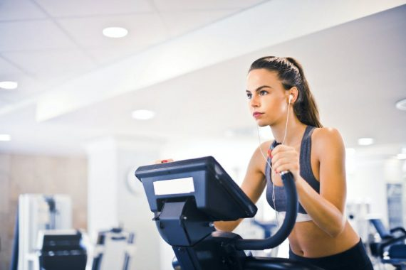 Woman using an exercise machine for workout
